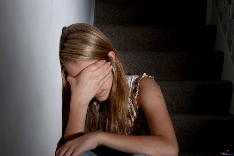 1387998685_young-girl-sitting-on-dark-stairs-1794430